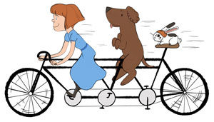 Red headed girl on bike with dog